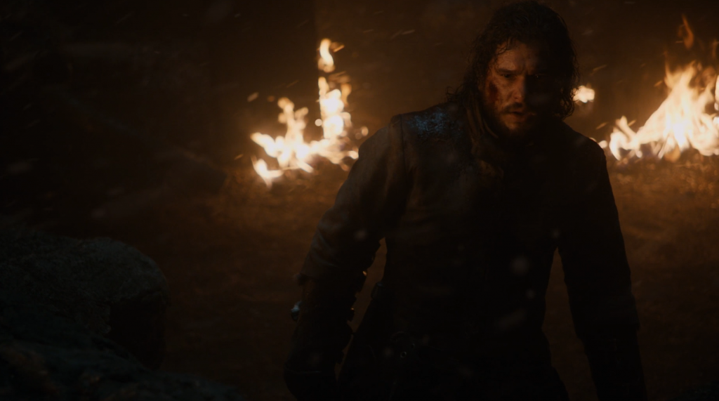 Jon Snow standing in disbelief after screaming at a dragon.